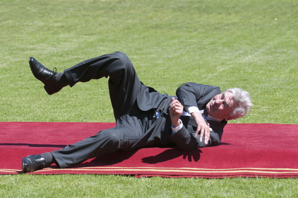 Former Prime Minister of the Netherlands Ruud Lubbers falls after tripping on the red carpet as he arrives to the Cerro Castillo presidential palace for lunch with other visiting dignitaries in Vina del Mar, Chile on March 11, 2014. Lubbers is in Chile to attend the inauguration ceremony of Chilean President Michelle Bachelet. AFP/FRANCESCO DEGASPERI (Photo credit should read FRANCESCO DEGASPERI/AFP/Getty Images)