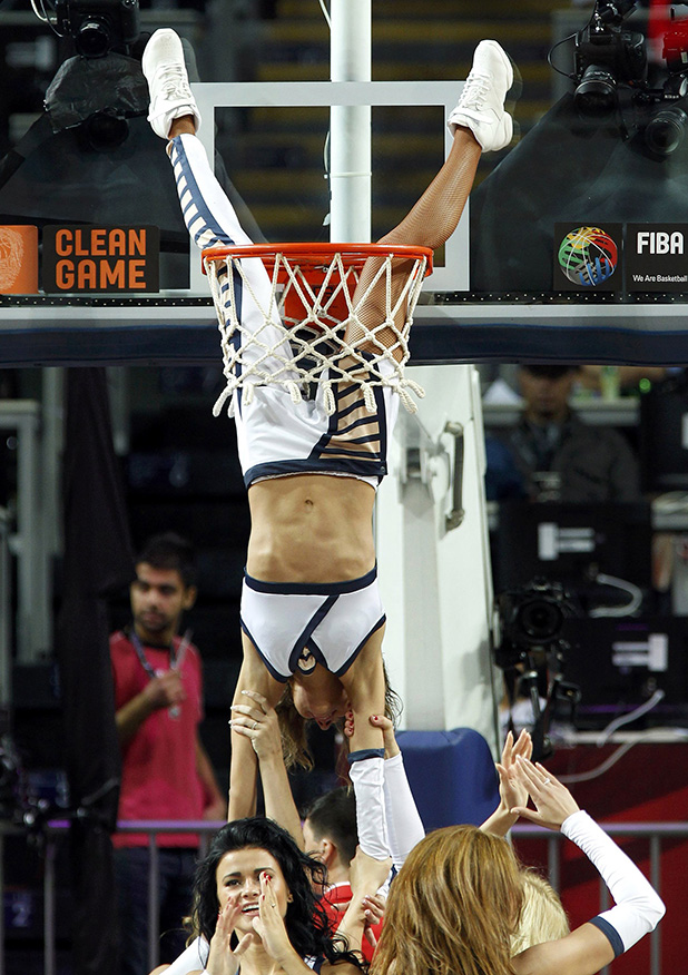 A cheerleader goes through the basket during FIBA Basketball World Championship game between Slovenia and Australia in Istanbul